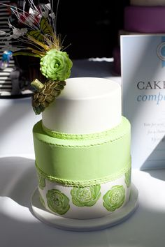 Two cakes stacked together with separate designs