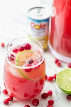 Cranberry Pineapple Punch With Pineapple Juice Cranberry Juice Cocktail Ginger Ale Frozen Cranberries Lime Ice Christmas Cocktails, Holiday Drinks, Summer Drinks, Fun Drinks, Holiday Recipes, Christmas Holiday, Beverages, Non Alcoholic Christmas Drinks, Alcoholic Desserts