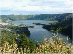 The Azores. This photo is on the island of Sao Miguel and shows Sete Cidades, a lake that is blue on one end, green on the other. Vanuatu, Norfolk, Las Azores, Places Around The World, Around The Worlds, Islas Cook, Family Vacation Spots, Twin Lakes, Viajes