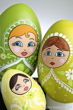 We made this darling little trio of eggs by first priming them with coordinating shades of green paint. When they were dry, we used acrylic paints and a fine-tipped paint pen to turn them into pretty nesting dolls. (Click for templates!)