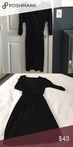 Chic black dress Tres Elegante! Plunging V neckline, a sash belt, front pleating and POCKETS!! Love this dress. Sadly, my waistline does not. Chris McLaughlin Dresses Midi
