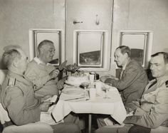 President Roosevelt prepares to cut his birthday cake on Jan 30, 1943, his 61st birthday, while airborne from Trinidad to Miami. Next to him is Adm William Leahy. His adviser and confidant Harry Hopkins sits across from him. Next to Hopkins is Lt Commander Cone. In a little more than a year after this photo was taken, Roosevelt would be dead.