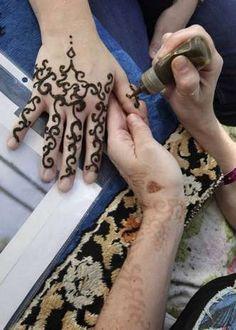 Henna at the Iowa State Fair! photo by Mary Chind, desmoinesregister.com #Henna #Iowa_State_Fair