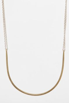 Lila Rice Two Way Arc Necklace, $300, urbanoutfitters.com