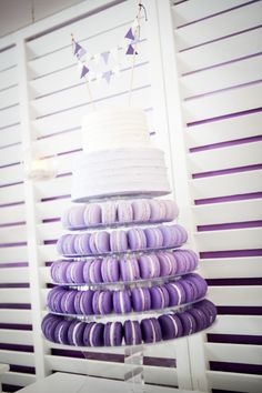 Purple ombre macaron tower with two tier cake.
