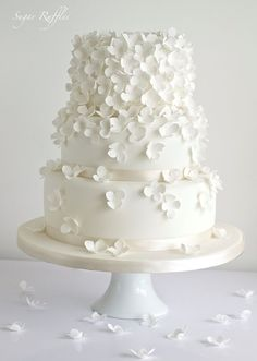 Obsessed! floral white 3-tiered wedding cake. Pair it with perfect wedding hair and makeup: http://vensette.com/bridal_inquiries