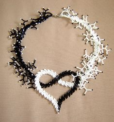Beaded heart necklace inspiration black and whiteBrick or Peyote with Coraling Heart Necklace - Interesting use of color and form Seed Bead Necklace, Seed Bead Jewelry, Bead Jewellery, Beaded Earrings, Gemstone Jewelry, Beaded Bracelets, Black Necklace, Pearl Necklace, Beaded Jewelry Patterns