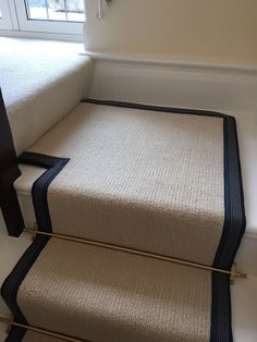 Riviera Henley Chiffon striped cream carpet fitted as stair runner with striped blue taping with Brass stair rods on white painted staircase White Staircase, Carpet Staircase, Hallway Carpet, Staircase Design, Staircase Remodel, Striped Carpet Stairs, Striped Carpets, Cream Hallway, Cream Carpet
