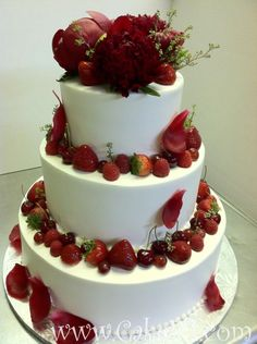 3 tier Fresh cream icing decorated with red peony flowers and mixed with fresh fruits.
