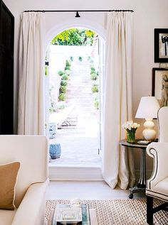 curtains framing arched doorway