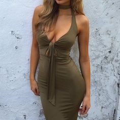 """Elegant and sexy deep V dress with a sweet bow in front.  *Size runs slightly small, order one size up. *Length: 92 cm 