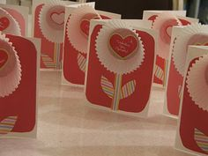 smaller cupcake liners on a kraft paper bag with heart-shaped-thank-you tag in the middle? <3