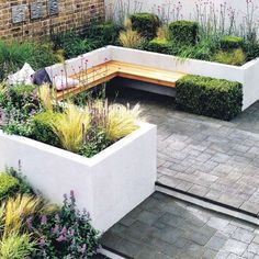 Contemporary patio layout for courtyard garden. Architectural plants give added interest to this sleek design.