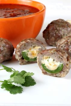Armadillo Eggs (cheese stuffed jalapenos wrapped in sausage).  I may have to try these at a party.  I'm not eating these, but they could be nice for others.