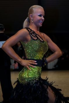 Yuriy Simachev & Anastasia Klokotova - 51st City of Gold Cup 2012 - [Interesting one-shoulder variation combined with belt] Video: http://www.youtube.com/watch?v=jkpEXGQY944 Photos: http://dancesportinfo.net/Couple/Yuriy_Simachev_and_Anastasia_Klokotova_106354/Gallery/AnneProvost_6/Competition/51st_City_of_Gold_Cup_14530/WDSF_International_Open_Latin_167126/Photos.aspx
