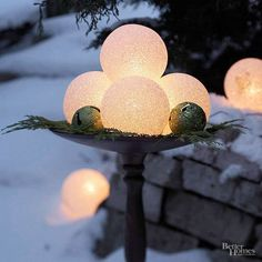 Glowing frosted globes (available in large and small sizes from home-improvement stores) take the edge off a chilly winter twilight. Scatter the spheres around your yard to create an ethereal winter landscape, or group them in a birdbath or other outdoor winter container for maximum impact. Editor's Tip: Plug the outdoor-rated power cord into a ground fault interrupter (GFI) outlet or a circuit with a GFI outlet on it.