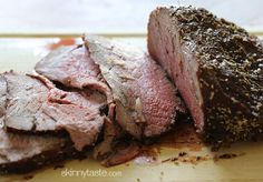 Garlic Lover's Roast Beef      2-3 lb roast or eye round, all fat trimmed off     3-4 cloves garlic, cut into thin slivers     olive oil spray (I used my misto)     kosher salt, to taste     fresh cracked pepper, to taste     2 tsp dried chopped rosemary