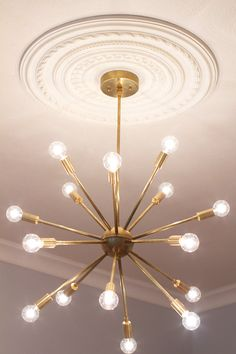 > > > Mid Century Modern Round Sputnik Chandelier by LucentLightshop - Would look good in chrome/silver.