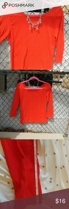 J.Crew top Maybe worn one time. Perfect condition. This beautiful orange shirt has 3/4 length sleeves and is tagged a large, but runs smaller in my opinion. (See pics for measurements). It has a ballet neck that is higher in the front and lower in the back.  The necklace is not included with this listing but I have listed it separately if you are interested. J. Crew Tops Tees - Long Sleeve