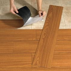 Peel and stick flooring that looks like wood. Great idea for renters. As seen on the Rachael Ray Show Today.