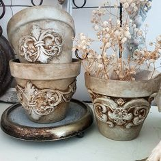 Go from drab to fab using our [re]design moulds on plain clay pots, add any finish you like and voila! You have beautiful vessels for your plants. These beauties were made by Magdalena from Secret Garden Chic Pots D'argile, Clay Pots, Altered Tins, Altered Art, Altered Bottles, Orchard Design, Painted Vans, Plaster Art, Iron Orchid Designs