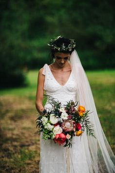 Bride wearing flower crown and veil with colourful bouquet | Wedding Photography by Honey and the Moon Photography Northern Ireland | www.honeyandthemoonphotography.co.uk