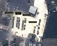 The satellite imagery shows tanks, armoured personnel carriers and transport trucks at the...