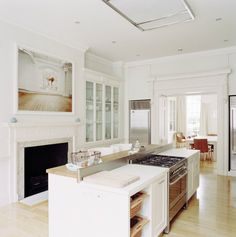 "nadineandrealynch: "" (via EAT / White Kitchen // London-based Rundell Associates) "" Kitchen Dining, Kitchen Decor, Kitchen Units, Fireplace In Kitchen, 1920s Kitchen, Fireplace Glass, White Fireplace, Nice Kitchen, Kitchen Stove"