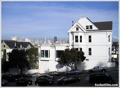 940 Grove Street, The Probert House, built 1895, seen from Alamo Square. the school addition is seen to the left of the mansion.