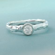 A personal favorite from my Etsy shop https://www.etsy.com/listing/94409621/twig-engagement-ring-white-sapphire-and