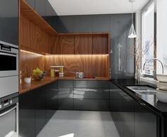 U shaped Kitchen with gloss unit doors and wooden clad walls