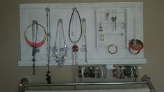 Sweet jewelry board with glass door knobs as hooks. #handmade