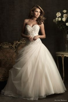 strapless sweetheart neckline ball gown with draped skirt and bodice adorned with embroidery and Swarovski crystals