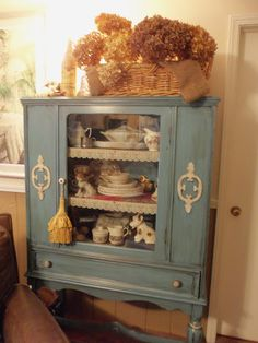 Turquoise china / buffet / hutch, hand painted and distressed with glaze and wax. Follow link for how to.