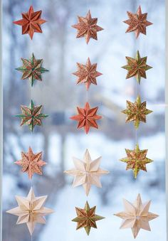 Decorations for Christmas, origami star curtains for the kitchen (from Kootut murut blog). Folding instructions here: http://www.origami-instructions.com/origami-8-pointed-star.html