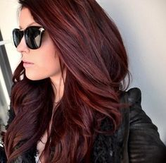 Long , curled, Dark red / auburn ombre hair . With black monogram sunglasses.