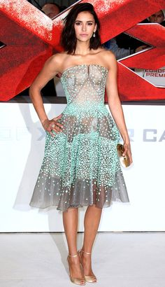 Nina wore a sheer Zac Posen strapless seafoam green dress paired with gold strappy heels! First off I have to say I love Nina's new short hair! Second I adore this dress! What a fun dress!