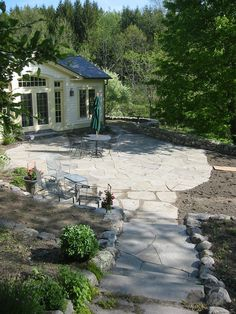 Flagstone Walkway Design Ideas broken piece flagstone walkway cuts through the center of this thick garden Flagstone Walkways Natural Flagstone Patio With Stone Walkway