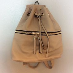 Forever 21 Hobo Style Backpack -Brand New Forever 21 cream/nude faux leather medium sized backpack with drawstring top closure and front zipper compartment. Gold metal fasteners. Adjustable backpack straps. 2 small pockets and a zipper compartment inside.  Please contact with any questions! Forever 21 Bags Backpacks