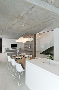 OOOOX | OSICE - kitchen and dinning room with floating table