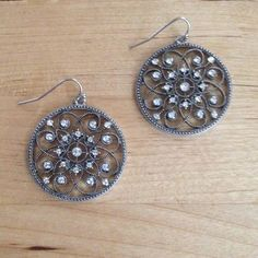 Circular Earrings Silver metal with just enough bling! Outer edges and inner swirls are all etched. Approximately 3.5 cm long. Jewelry Earrings