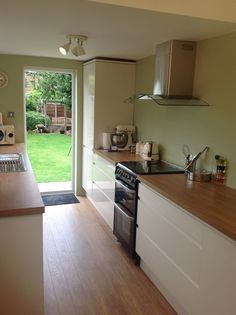 My Beautiful new  kitchen... Howden's iintegrated cream high gloss with Farrow and Ball's Cooking Apple Green on the walls.... yummy! LH