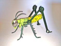 Whimsical Upcycled Metal Grasshopper Sculpture. $150.00, via Etsy.