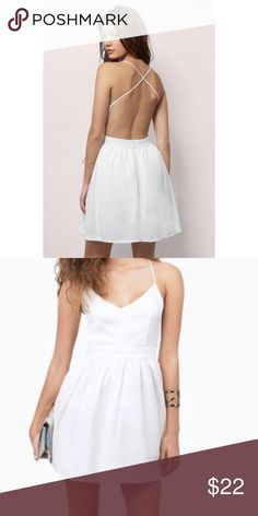 TOBI white skater dress Brand new, with tags. super cute white skater dress with straps crossing in the back and a tulle slip. perfect for sorority initiation, bridal shower, bachelorette party, or a cocktail party! The front is a bit sheer, so a sticky bra is a must. 100% polyester & a closet staple for sure Tobi Dresses Mini
