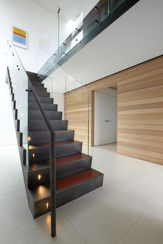 Minimalist Modern House in Cube Shape: Fantastic And Contemporary Home Interior Design Ideas Of Black Indoor Staircase With Glass Fence To E...