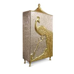 Designed passionately and exquisitely by the incomparable talents powering Koket; the Camilia was created to grace the most regal of dining rooms with its elegance and splendor. Inspired by the aristocratic palaces of the Alexandrian pashas of Egypt; the mother of pearl Camilia is crowned by artisan hand-carved peacock; meticulously engraved and delicately finished in gold leaf. It is only fitting that the Camilia treasures be concealed by the most graceful of keys.This Elegant cabinet…