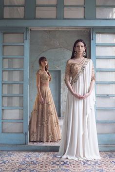 Ivory & Gold Lehenga with an Embroidered Cape – Bhaavya Bhatnagar Drape Gowns, Draped Dress, Indian Gowns Dresses, Bridal Dresses, Pakistani Cape Dresses, Prom Dresses, Indian Wedding Outfits, Indian Outfits, Indian Designer Outfits