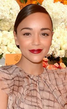 Ashley Madekwe stuns with a simple beauty look featuring dewy skin, long lashes and Avon Ultra Color Lipstick in Cherry