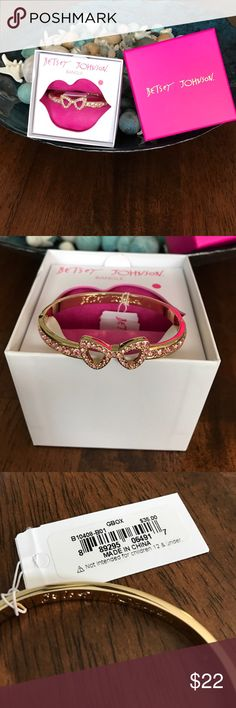 Betty Johnson bracelet Beautiful gold bracelet featuring pink rhinestones around the bow and bracelet. Just perfect for a special Valentine. Never worn, tags still in place, see pictures. Gift box is included Jewelry Bracelets