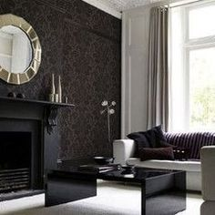Dark, matte walls are a must for any home theater. Black damask wallpaper keeps it interesting.